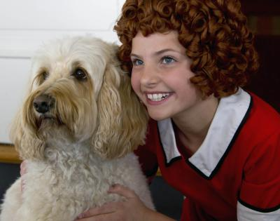 "Photo by Tracy Martin Maya Donato, right, with Scooter, ready to star in ""Annie"" for Broadway by the Bay."